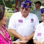 Congresswoman Mazie K. Hirono discusses issues with Korean War veterans Joe Lopez and Thomas Tanaka during the Pacific American Foundation Roll Call of Honor in Remembrance Ceremony at the National Memorial Cemetery of the Pacific at Punchbowl. May 29, 2011.