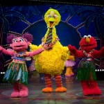 "Big Bird does the hula with friends Abby Cadabby & Elmo in ""1-2-3 Imagine!""   Photo courtesy, Sesame Street Live."