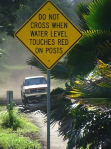 This sign is posted at the ʻUlaino River in East Maui, which can overflow during heavy rains, making the road impassable. File photo by Wendy Osher.