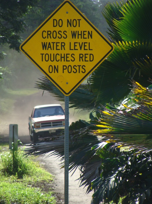 This sign is posted at the Ulaino River in East Maui, which can overflow during heavy rains, making the road impassable. File photo by Wendy Osher.