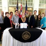 Senators join Governor Abercrombie after the signing of Senate Bill 1520 into law. Photo courtesy: Senate Communications.