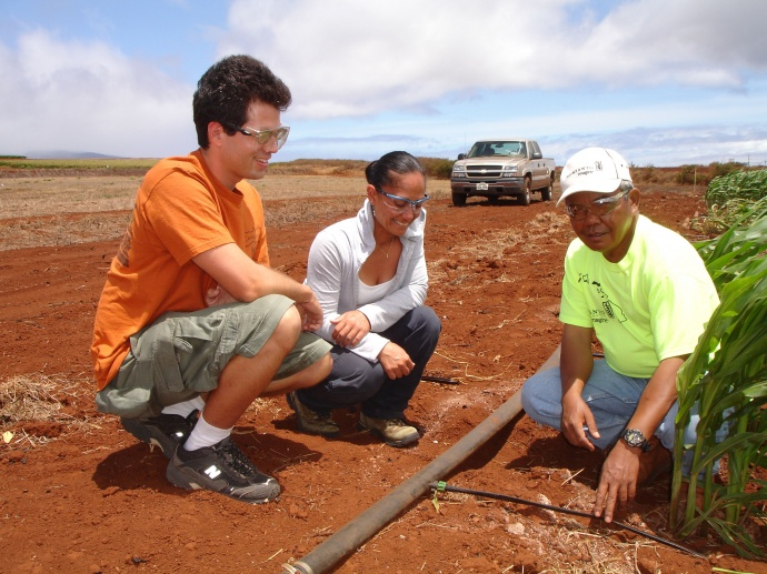 Monsanto's Alex Mangayayam (right) explains the company's drip irrigation system to  Nature Conservancy Moloka'i staff members Russell Kallstrom (left) and Wailana Moses (center).   Photo courtesy,  Monsanto Moloka'i.