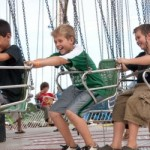Having a great time on swings, image courtesy of Maui Fair