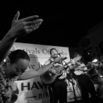 A hula dancer says it all - graceful arms open, sharing the aloha spirit. Photo by Lisa Villiarimo.