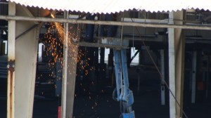 Crews worked to remove portions of the old Kahului cannery roof.