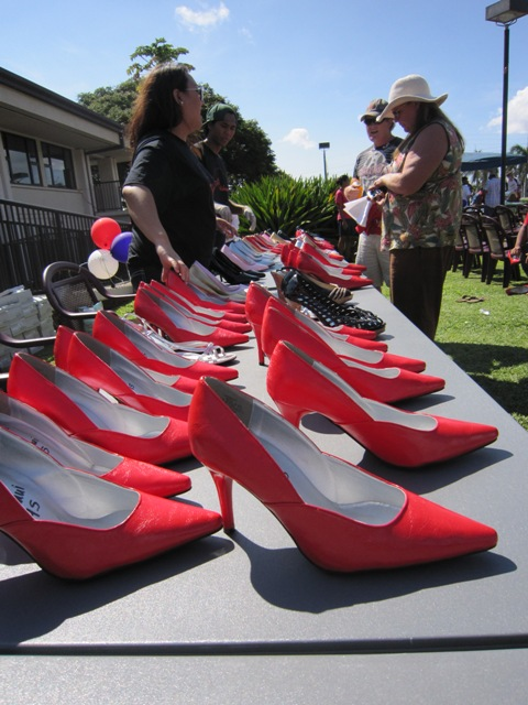 Ready for Action! Walk a Mile in Her Shoe's organizers handed out red heals to male participants. File photo by Katie McMillan.