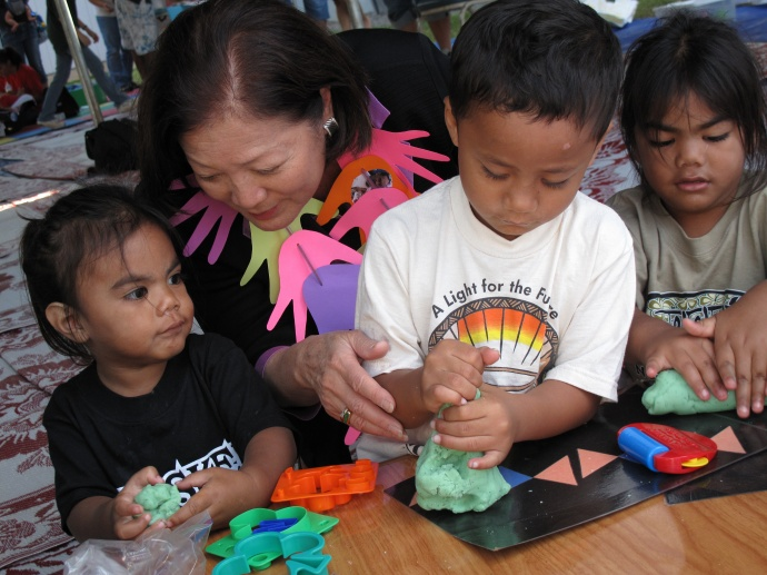 Congresswoman Hirono assists young children at the Tutu and Me traveling preschool program. File photo courtesy, Office of Rep. Mazie Hirono.