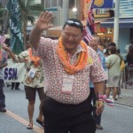 Mayor Arakawa leading the Hawai`i delegation during the Taikai Parade in Okinawa.  Photo courtesy County of Maui.
