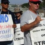 Hawaiian Telcom IBEW workers on Maui set up a picket line on Wakea Avenue in Kahului, a few miles away from the company's offices in Wailuku.  Photo by Wendy Osher.