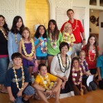 A&B Foundation President Meredith Ching (center, kneeling) is surrounded by youth center members from Kihei, Pa'ia and  Boys & Girls Club Maui who represented their centers at a grant presentation on Wednesday, held at the Hui No'eau.  Each group made a special presentation in accepting the grant, including testimony on safe play choices for their fellow youth.  The ti leaf lei Ching wears was presented by Hana Youth Center members (not able to attend).  Center staff are (far left standing) Kihei Youth Center's Leslie Garcia, BGCM's Maurice Bajon (standing far right) and PYCC's Ana Makoni (kneeling middle right).