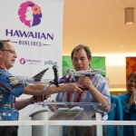 JetBlue CEO Dave Barger and Hawaiian Airlines CEO celebrate a new partnership. (PRNewsFoto/JetBlue Airways)