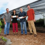 Kihei Charter School will be using Monsanto's grant funds to purchase supplies for renewable energy experiments and hands-on lessons in physics. Pictured (left to right):  Paul Koehler (Monsanto Hawaii), Melinda Roth (Kihei Charter School), Dan Kuhar (Kihei Charter School), David Stolzfus (Monsanto Hawaii).  Courtesy photo.