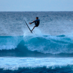 A surfer at Hookipa Beach in early evening. Photo by Madeline Ziecker.