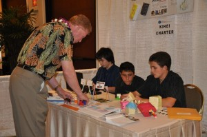 Rep George Fontaine visiting students booth at STEM conference