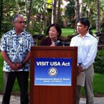 Congresswoman Hirono joined by Mike McCartney, President and CEO of the Hawai'i Tourism Authority (left), and Roy Yamaguchi, Board Member of Brand USA (right), at Waikiki's Royal Hawaiian Center to unveil the Visit USA Act to boost tourism and jobs in Hawaii. Courtesy photo.