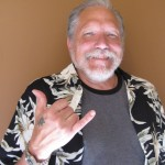 Looking tanned and relaxed and wearing his new aloha shirt Jourma Kaukonen flashes a Hawaiian shaka.  Susan Halas photo.
