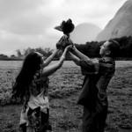Aulani Shiu and Dayton Kupele offer hookupu to their Kalaupapa ancestors in this 2010 picture taken by Wayne Levin.