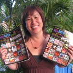 """Maui needs this,"""" said Carolyn Quan, event organizer, holding up copies of the Open Studios guide.  Susan Halas photo."""