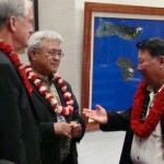 Maui Mayor Alan Arakawa speaks with Council Members Mike White and Joe Pontanilla following the deliver of his 2012 State of the County Address.  Photo by Wendy Osher.