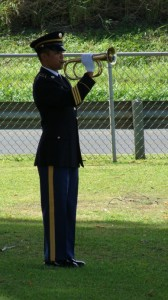 The Hawai'i Army National Guard Funeral Honors Team, playing Taps at the unveiling ceremony in honor of PFC Anthony T. Kaho'ohanohano. Photo by Wendy Osher.