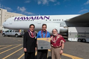 State Senator J. Kalani English (left) and Governor Neil Abercrombie (right), present a plaque to Mark Dunkerley, Hawaiian's president and CEO. Courtesy of Hawaiian Airlines.