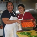Kitchen works Socorro Ortega and Marta Momge produce the chili and carrots that are salsa bar favorites. Susan Halas photo.
