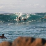 In this situation the surfer closest to the peak (far left) has the right of way. Ho'okipa Beach Park. Photo by Carlos Rock.