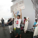 Maui surfer Hank Gaskell holds the winner's check worth $8,000. Photo by TONYROBERTSPHOTO.COM.