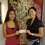 Nicole Fukumoto (right), presents a scholarship award to Kiara Galicinao.  Courtesy photo.