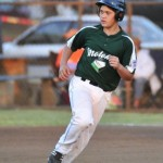 Molokai's Kairos Torres-Umi rounds second base after hitting a two-run homer in the first inning Wednesday at Kalama Park. Molokai defeated Central East Maui, 2-1. Photo by Glen Pascual.