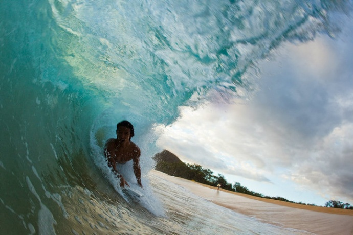 Bodyboarder inside the tube at Big Beach. Photo: Carlos Rock