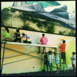 The kids worked intently to help create Makawao's largest mural. Photo by Vanessa Wolf