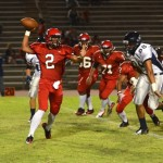 Lahainaluna quarterback Kiko Kolher-Fonohema throws a completion in the first half Friday against Kamehameha Maui. Photo by Rodney S. Yap.