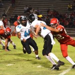Lahainaluna's Connor Rosen-St. John (52) sacks King Kekaulike quarterback Ryley Widell. File photo by Rodney S. Yap.
