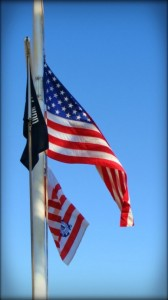 Flags at half-staff. File photo by Wendy Osher.