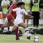 Hawaii's Tiana Fujimoto dribbles through BYU-Hawaii's defense on Monday. Photo by UH Athletics.
