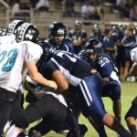 Kamehameha Maui's Taylor Kaaukai (23) scores the 1-yard out for the Warriors' only touchdown of the game. Photo by Rodney S. Yap.