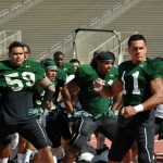 UH football team performs the Ha'a before the start of its Maui practice. The new era under coach Norm Chow begins today when UH plays No. 1 USC at 1:30 p.m. File photo by Rodney S. Yap.