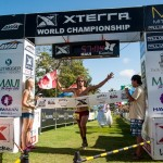 Men's winner Willie Schefer crossing the finish line first of the Duke's Beach House 10K on Saturday. Photo by XTERRA Photos.