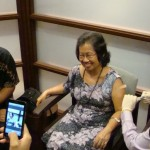 Maui Mayor Alan Arakawa (left) looks on as his wife Anne, gets a flu shot from Photo by Wendy Osher.