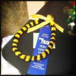One of Hanna's student's traditional feather lei made with Royal colors and in kamoe style took first place at the Fair.
