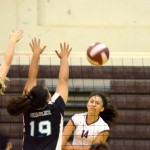 Baldwin's Oliva Wallace hits through the block of King Kekaulike's Caitlyn Cole (18) and Hi'ilei Mahuka-Kihewa (19). Photo by Rodney S. Yap.