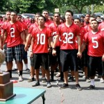 The Lahainaluna football team sings its alma mater in the parking lot of the Honokawai Times Supermarket, Oct. 7. Photo by Thad Fujiwara / Times.Supermarkets.