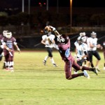 Baldwin High wide receiver Larry Gines (80) goes airborne for this catch over the middle in the first quarter Saturday night against King Kekaulike. Photo by Rodney S. Yap.