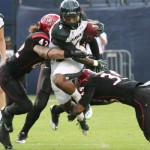 Hawaii running Will Gregory runs through San Diego State's defense Saturday. Photo courtesy of UH Athletics.