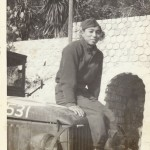 Hiroshi Arisumi on a US Army Jeep during World War II.