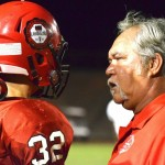 Lahainaluna co-head coach Bobby Watson talks with Tytus Lucas during a game earlier this season. Photo by Rodney S. Yap.