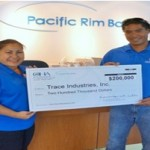 General contractor Tracy Poepoe, (right), and his wife, Shareen, receive loan from OHA to help expand their Native Hawaiian-owned small business. Photo courtesy of OHA.