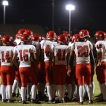 The Lahainaluna football team huddle before its first MIL game of the 2012 season. Photo by Rodney S. Yap.