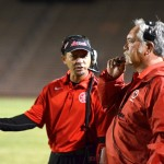 Lahainaluna High School defensive backs coach Kenui Watson (left) looks at his dad, Bobby Watson, the team's co-head coach and defensive coordinator during a game earlier this season. Photo by Rodney S. Yap.